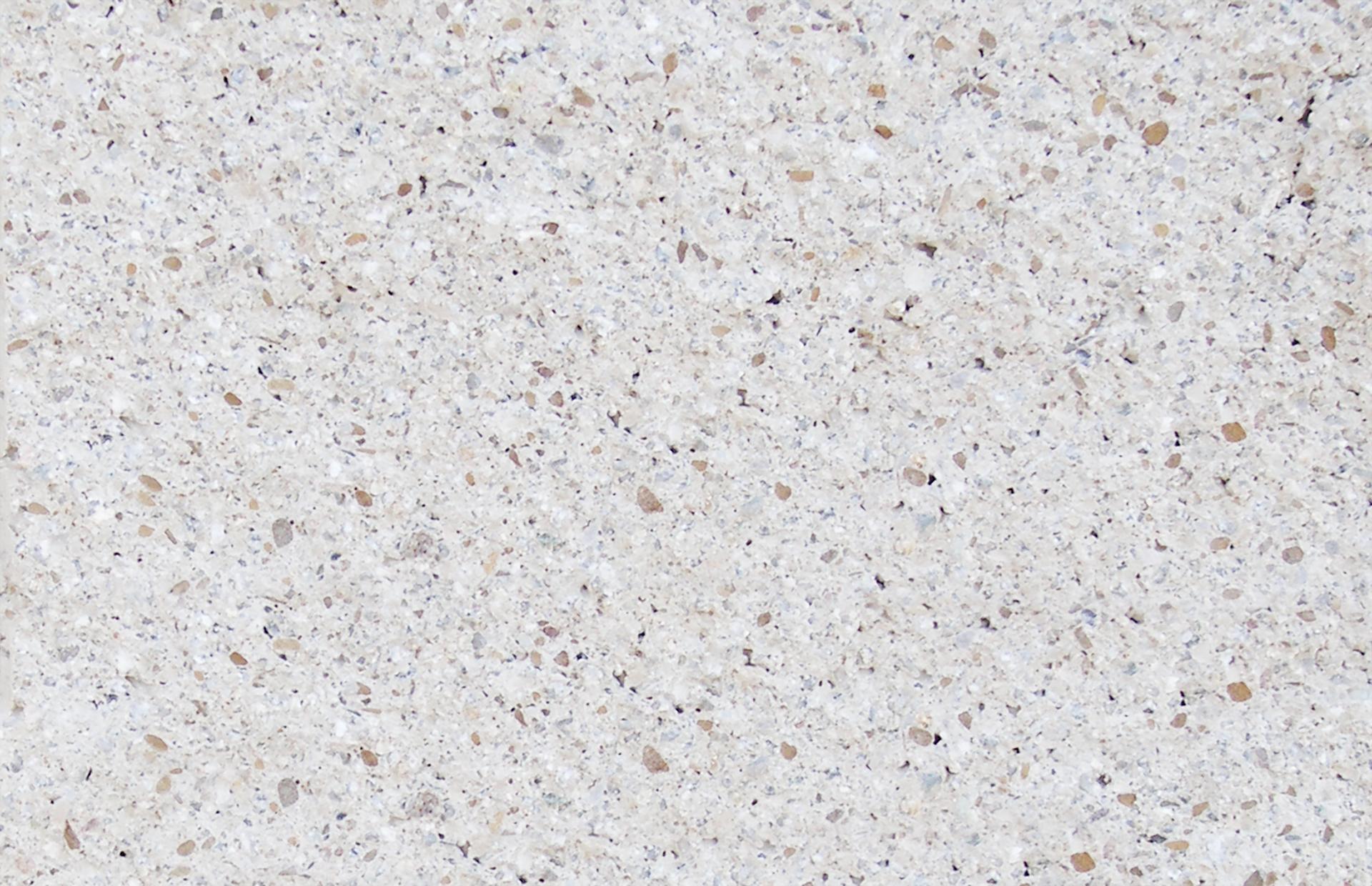 Biela lámaný kameň